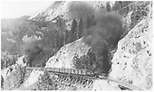 Leased D&amp;RGW K-27s #464 and #462 crossing RGS High Line trestles (46-D, 46-E, 46-F).<br /> RGS  Ophir Loop, CO  Taken by Perry, Otto C. - 6/26/1945