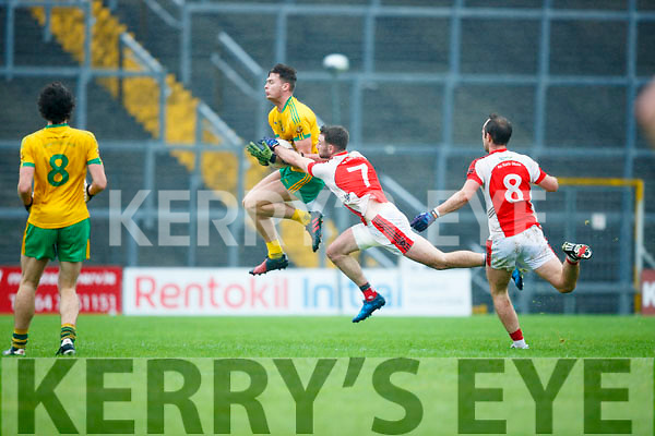 Brendan O'Keeffe Rathmore is beaten to the ball by Conor Herlihy Gneeveguilla