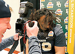 Baylor guard Cyril Richardson shakes his hair for photographer Gene Lower during the Fiesta Bowl media Day, Monday, Dec. 30, 2013, in Scottsdale, Ariz. Baylor will face Central Florida on Jan. 1, 2014 in the Fiesta Bowl NCAA college football game. AP Photo/Matt York)