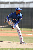 Victor Payano of the Texas Rangers plays in a minor league spring training game against the Kansas City Royals at the Rangers minor league complex, on March 22, 2011  in Surprise, Arizona. .Photo by:  Bill Mitchell/Four Seam Images.