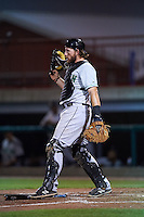 Clinton LumberKings catcher Adam Martin (27) kicks a bat out of the way during a game against the Burlington Bees on August 20, 2015 at Community Field in Burlington, Iowa.  Burlington defeated Clinton 3-2.  (Mike Janes/Four Seam Images)