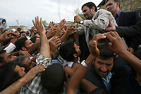 Iranian President Mahmoud Ahmadinejad is mobbed by majority farmer supporters during a provincial visit to Golestan Province.