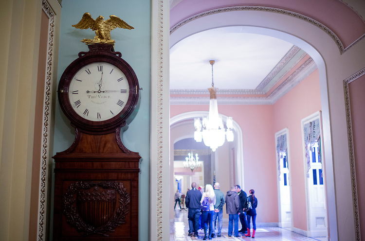 UNITED STATES - OCTOBER 11: The Ohio Clock on the Senate side of the Capitol remains stuck at 12:14 curators who wind the clock have been furloughed during the government shutdown. (Photo By Bill Clark/CQ Roll Call)