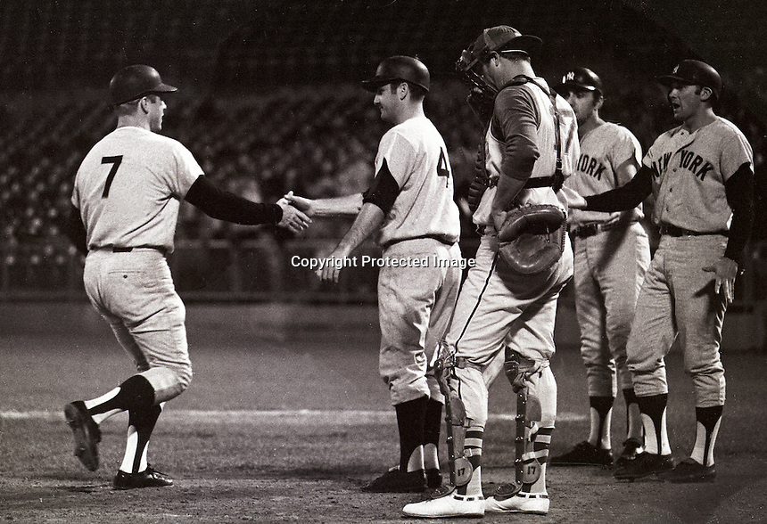Mickey Mantle HR greeted at home by Yankee teamates. Against the Oakland A's 1969. .photo/Ron Riesterer