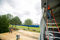NWA Democrat-Gazette/JASON IVESTER<br /> Hendy (cq) Magloire (cq) with TentLogix works on the new seating area called Hub479 Wednesday, June 14, 2017, which overlooks the 17th green at Pinnacle Country Club in Rogers. Events begin Monday for the LPGA Wal-Mart NW Arkansas Championship.