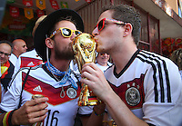 Germany supporters kiss a replica World Cup trophy