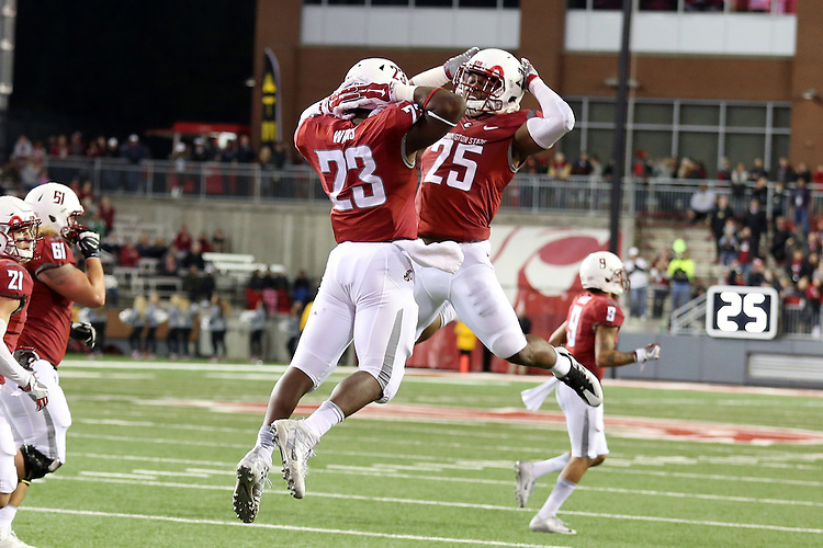 Gerard Wicks (23) and Jamal Morrow (25), Washington State running backs, celebrate another score during the Cougars Pac-12 Conference destruction of the Cal Bears, 56-21, on November 12, 2016, at Martin Stadium in Pullman, Washington.