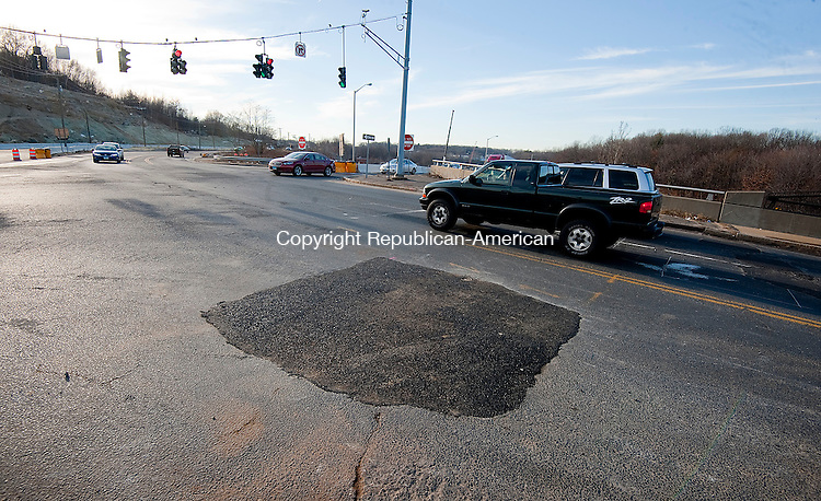 WATERBURY, CT--- -010716JS05--Fresh patch of asphalt on Harpers Ferry Road in Waterbury after crews repaired a broken water main from Wednesday night. <br /> Jim Shannon Republican-American
