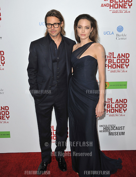 "Brad Pitt & Angelina Jolie at the Los Angeles premiere of her new movie ""In The Land of Blood and Honey,"" which she wrote & directed, at the ArcLight Theatre, Hollywood..December 8, 2011  Los Angeles, CA.Picture: Paul Smith / Featureflash"