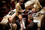 State Representative Harry Shiver (R) reacts as he talks to representatives during a session at the Alabama State House in Montgomery, Alabama April 14, 2010.
