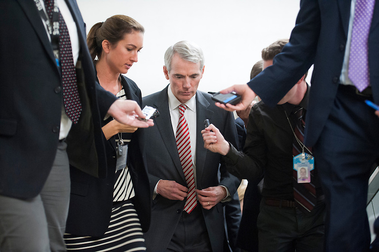 UNITED STATES - Oct 29:  Sen. Rob Portman, R-OH., talks with reporters on the way to the Senate policy luncheons in the U.S. Capitol on October 29, 2013.   (Photo By Douglas Graham/CQ Roll Call)
