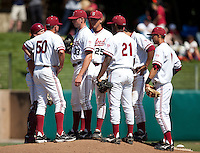 STANFORD, CA - April 17, 2011: Pitching coach Rusty Filter of Stanford baseball talks with Chris Reed and the rest of the infield at the mound during Stanford's game against Oregon State at Sunken Diamond. Stanford lost 6-4.
