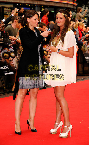 "EMMA GRIFFITHS & DANIELLE LLOYD.Attending the UK Gala Premiere of ""Hancock"" held at the Vue West End, Leicester Square, London, England. .June 18th 2008.full length gold hairbands headband necklace trim white brunette hair dress bag peep toe shoes black coat jacket interview microphone side view profile .CAP/CAN.©Can Nguyen/Capital Pictures."