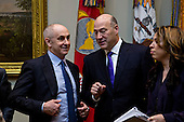 Gary Cohn, director of the U.S. National Economic Council, center, talks while waiting to begin a meeting of small business leaders with U.S. President Donald Trump, not pictured, in the Roosevelt Room of the White House in Washington, D.C., U.S., on Monday, Jan. 30, 2017. Trump defended the immigration clampdown that sparked a global backlash over the weekend by blaming the confusion at airports on protesters and on a computer outage at Delta Air Lines Inc. that caused flight cancellations. <br /> Credit: Andrew Harrer / Pool via CNP
