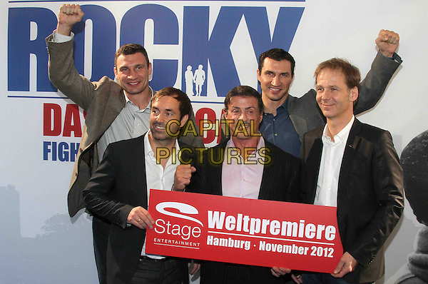 Vitali Klitschko, Michael Hildebrandt, Sylvester Stallone, Wladimir Klitschko and Johannes Mock-OHara .Photocall for the musical 'Rocky' at stage entertainment headquarter, Hamburg, Germany. .November 20th, 2011.half length hand fist arm in air blue black grey gray pink shirt.CAP/PPG.©People Picture/Capital Pictures