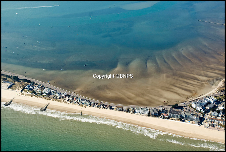 BNPS.co.uk (01202 558833)<br /> Pic: Peter Willows/BNPS<br /> <br /> Aerial of Poole Harbour, Sandbanks.<br /> <br /> The new owners of a luxury home on Sandbanks will have to pass an interview with their multi-millionaire neighbour before they can buy it. <br /> <br /> Businessman Ashley Faull is building two seafront homes on one large plot on the exclusive Dorset peninsula; one for him and his wife and the other which he intends to sell for £4m.<br /> <br /> But just meeting the hefty asking price won't be enough for prospective buyers as Mr Faull, 51, insists on holding informal interviews with them to make sure the couple will get along with their new neighbours.<br /> <br /> And he said he is even prepared to sell the brand new three bedroom property called 'Sunshine' for less than the asking price if it means finding the right buyer.