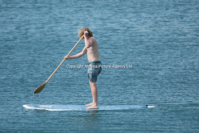 Aberystwyth Wales UK, Thursday 12 May 2016<br /> UK Weather: A young man paddle boarding in the sea at the seaside in  Aberystwyth, on the Cardigan Bay coast of west Wales, enjoying a last day of warm weather in the current mini-heatwave. <br /> The temperatures are set to fall over the coming days, with bright but colder conditions prevailing over the country