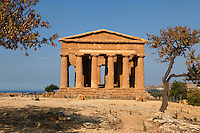 View from the front of the Temple of Concord, 5th century BC, Agrigento, Sicily, Italy,  pictured on September 11, 2009, in the morning. Well preserved owing to its 6th century AD conversion to a church, the Temple of Concord is a typical example of optical correction whose tapering columns create the illusion of a perfectly aligned building. Its frieze consists of alternating triglyphs and metopes, and the pediment is undecorated. The Valley of the Temples is a UNESCO World Heritage Site. Picture by Manuel Cohen.