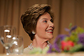 First lady Laura Bush laughs during the annual White House Correspondents' Association dinner at the Washington Hilton in Washington, D.C., Saturday 30 April 2005. President George W. Bush and Laura Bush headlined the dinner with his speech along with Cedric The Entertainer. The annual dinner began in 1914 as a bridge between the White House and its media corps and tonight feautured a mix of political insiders including Supreme Court Justices, Antonin Scalia and Stephen Breyer, and Hollywood elite such as Goldie Hawn and Richard Gere.<br /> Credit: Katie Falkenberg - Pool via CNP