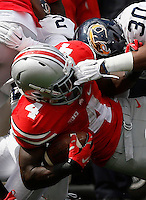 Kent State Golden Flashes linebacker Dustyn Moore (30) grabs the face mask of Ohio State Buckeyes running back Curtis Samuel (4) during Saturday's NCAA Division I football game at Ohio Stadium in Columbus on September 13, 2014. Ohio State won the game 66-0. (Dispatch Photo by Barbara J. Perenic)