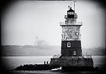B&W photo of Robbins Reef Lighthouse with Bayonne Golf Club in the Background