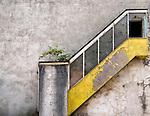 Derelict yellow stairway