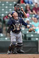 Durham Bulls catcher Craig Albernaz #4 watches a pop up in front of home plate umpire Mark Lolloduring a game against the Empire State Yankees at Frontier Field on May 13, 2012 in Rochester, New York.  Durham defeated Empire State 3-1.  (Mike Janes/Four Seam Images)