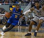 South Dakota State guard Tevin King (2)drives against Nevada's Jordan Caroline (24) in the scond half of an NCAA college basketball game in Reno, Nev., Saturday, Dec. 15, 2018. (AP Photo/Tom R. Smedes)