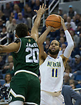 Nevada's Cody Martin shoots over Colorado State's Deion James in the first half of an NCAA college basketball game in Reno, Nev., Sunday, Feb. 25, 2018. (AP Photo/Tom R. Smedes)