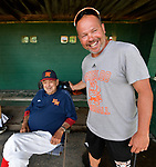 Mark Vogel (right) the current Waterloo High School baseball coach, greets Vern Moehrs, longtime manager of the Waterloo Millers men's baseball team, before the 48th Annual Valmeyer Mid-Summer Baseball Classic Tournament in Valmeyer, IL on July 4, 2019.  Vogel played for Moehrs for a dozen years and now helps the team by coaching third base. <br /> Photo by Tim Vizer