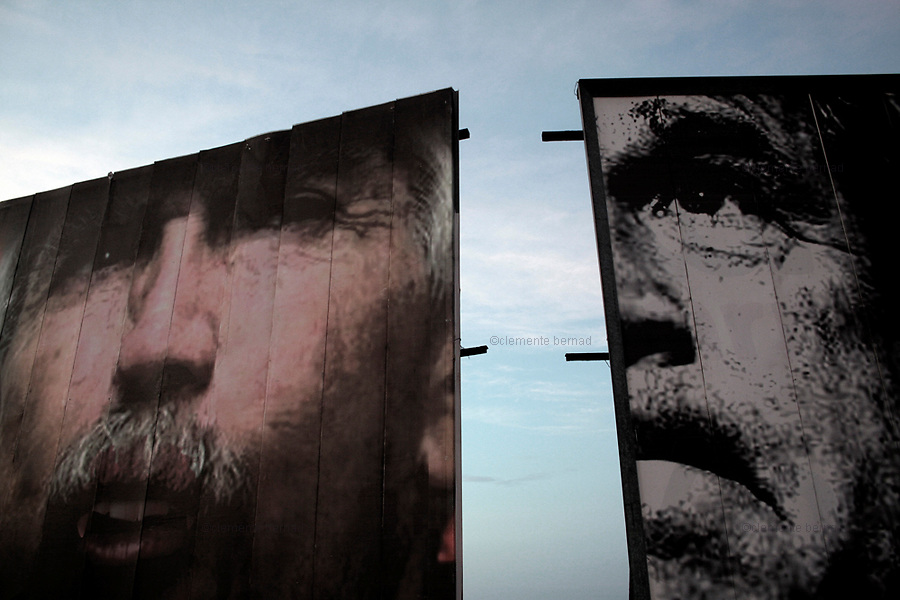 Havana (Cuba). September 2006..Malecón. Billboards against US President George Bus, Posada Carriles, etc,...,  in front of the United States Interests Section in Cuba, which displays messages against Cuban regime from the windows of their top floor on a scrolling electronic billboard