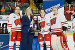 ST CHARLES, MO - MARCH 19:  Captains from the Wisconsin Badgers are presented with the Second Place trophy at the conclusion of the Division I Women's Ice Hockey Championship held at The Family Arena on March 19, 2017 in St Charles, Missouri. Clarkson defeated Wisconsin 3-0 to win the national championship. (Photo by Mark Buckner/NCAA Photos via Getty Images)