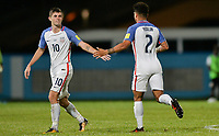Couva, Trinidad & Tobago - Tuesday Oct. 10, 2017: Christian Pulisic and DeAndre Yedlin celebrate CP's goal during a 2018 FIFA World Cup Qualifier between the men's national teams of the United States (USA) and Trinidad & Tobago (TRI) at Ato Boldon Stadium.