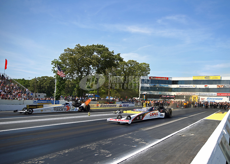 Jun 11, 2017; Englishtown , NJ, USA; NHRA top fuel driver Steve Torrence (near) races alongside Antron Brown in the final round of the Summernationals at Old Bridge Township Raceway Park. Mandatory Credit: Mark J. Rebilas-USA TODAY Sports