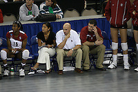 14 December 2006: Stanford Cardinal Foluke Akinradewo, director of volleyball operations Cobey Shoji, strength & conditioning coach Juan Pablo Reggiardo, and athletic trainer Eitan Gelber during Stanford's 30-12, 30-25, 30-15 win against the Washington Huskies in the 2006 NCAA Division I Women's Volleyball Final Four semifinal match at the Qwest Center in Omaha, NE.