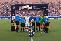 PASADENA, CA - AUGUST 4: Carli Lloyd #10, referees, and Katie McCabe #11 pose during a game between Ireland and USWNT at Rose Bowl on August 3, 2019 in Pasadena, California.