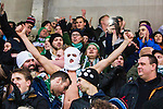 Stockholm 2014-03-01 Bandy SM-semifinal 1 Hammarby IF - V&auml;ster&aring;s SK :  <br /> V&auml;ster&aring;s supportrar med balaclava &auml;r glada under matchen<br /> (Foto: Kenta J&ouml;nsson) Nyckelord:  VSK Bajen HIF supporter fans publik supporters glad gl&auml;dje lycka leende ler le