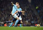 Harry Winks of Tottenham Hotspur is challenged by Kevin De Bruyne of Manchester City during the premier league match at the Etihad Stadium, Manchester. Picture date 16th December 2017. Picture credit should read: Robin ParkerSportimage