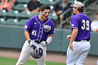Catcher Danny Bermudez (21) of Western Carolina shouts after hitting a home run in the ninth inning against Mercer in the final game of the SoCon Tournament championship series on Sunday, May 29, 2016, at Fluor Field at the West End in Greenville, South Carolina. Western won, 3-2. (Tom Priddy/Four Seam Images)