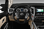 Car pictures of steering wheel view of a 2016 Nissan Titan SL 4 Door Pickup Steering Wheel