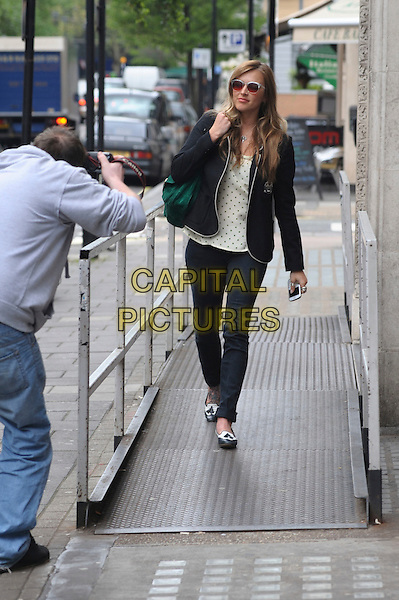 FEARNE COTTON.Seen leaving work after being away on holiday, BBC Radio 1, London, England, UK, May 4th 2010..one full length green suede bag sunglasses blue trousers jeans polka dot top cream blazer jacket brogues jazz shoes tattoo on foot flats photographer pap paparazzi being papped .CAP/DYL.©Dylan/Capital Pictures.