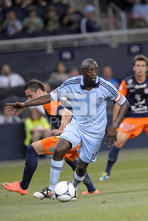 Lawrence Olum (13) defender Sporting KC in action..Sporting Kansas City were defeated 3-0 by Montpellier HSC in an international friendly at LIVESTRONG Sporting Park, Kansas City, KS..