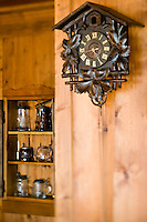 Close up of an antique cuckoo clock on the wall of the living room