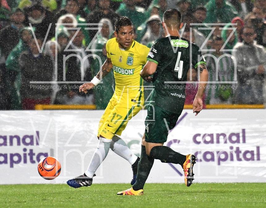 BOGOTA - COLOMBIA -25-02-2017: Horacio Aguirre (Der.) jugador de La Equidad disputa el balón con Dayro Moreno (Izq.) jugador de Atletico Nacional, durante partido entre La Equidad y Atletico Nacional, por la fecha 5 de la Liga Aguila I-2017, jugado en el estadio Nemesio Camacho El Campin de la ciudad de Bogota. / Horacio Aguirre (R) player of La Equidad vies for the ball with Dayro Moreno (L) player of Atletico Nacional, during a match between La Equidad and Atletico Nacional, for the  date 5 of the Liga Aguila I-2017 at the Nemesio Camacho El Campin Stadium in Bogota city, Photo: VizzorImage  / Luis Ramirez / Staff.