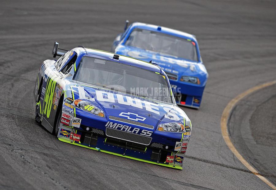 Nov. 9, 2008; Avondale, AZ, USA; NASCAR Sprint Cup Series driver Jimmie Johnson (48) leads Ryan Newman during the Checker Auto Parts 500 at Phoenix International Raceway. Mandatory Credit: Mark J. Rebilas-