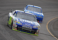 Nov. 9, 2008; Avondale, AZ, USA; NASCAR Sprint Cup Series driver Jimmie Johnson (48) leads Ryan Newman during the Checker Auto Parts 500 at Phoenix International Raceway. Mandatory Credit: Mark J. Rebilas-