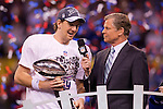 NBC's Dan Patrick interviews New York Giants Eli Manning (10) with the Vince Lombardi Trophy after beating the New England Patriots during the NFL Super Bowl XLVI football game on Sunday, Feb. 5, 2012, in Indianapolis. The Giants won 21-17 (AP Photo/David Stluka)...