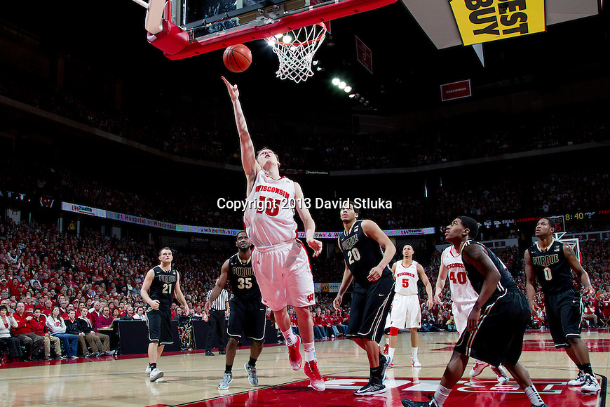 Wisconsin Badgers forward Sam Dekker (15) shoots a layup during a Big Ten Conference NCAA college basketball game against the Purdue Boilermakers Sunday, March 3, 2013, in Madison, Wis. Purdue won 69-56. (Photo by David Stluka)