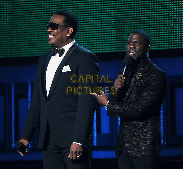 LOS ANGELES, CA - JANUARY 26 : (L-R) Charlie Wilson and Kevin Hart  speak onstage at The 56th Annual GRAMMY Awards at Staples Center on January 26, 2014 in Los Angeles, California.<br /> CAP/MPI/PG<br /> &copy;PGFMicelotta/MediaPunch/Capital Pictures