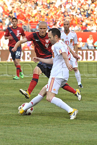 04.06.2011. Spain midfielder Andres Iniesta (6) tries to pass the ball back to a teammate and keep it away from United States midfielder Michael Bradley (4) during the Spain game against the USA at Gillette Stadium in Foxborough, MA